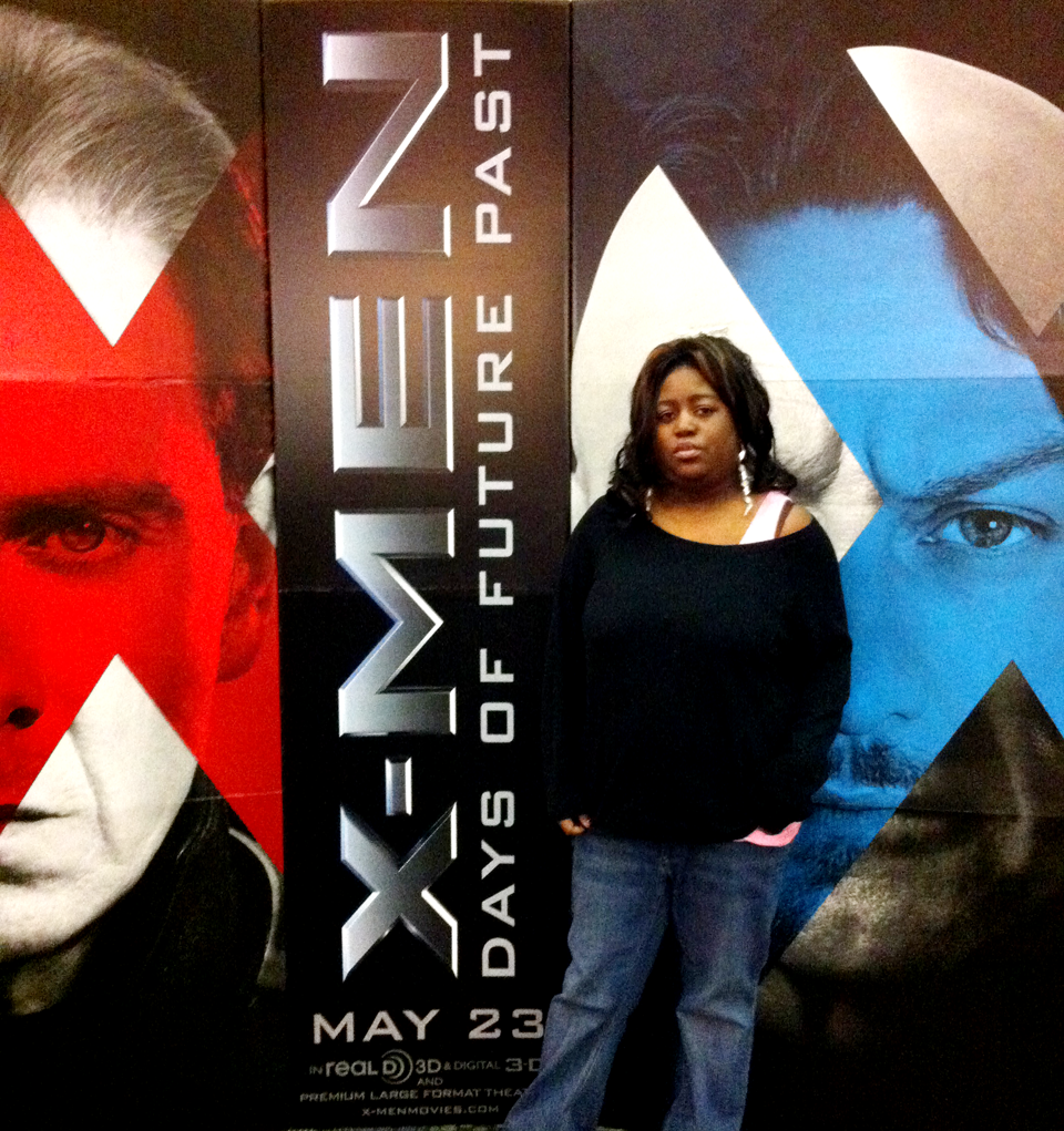 Photo by Brandon Beatty/Gaming Insurrection GI recently took a field trip to the movies. Editor-in-chief Lyndsey Hicks stands with the X-Men: Days of Future Past promotional poster.